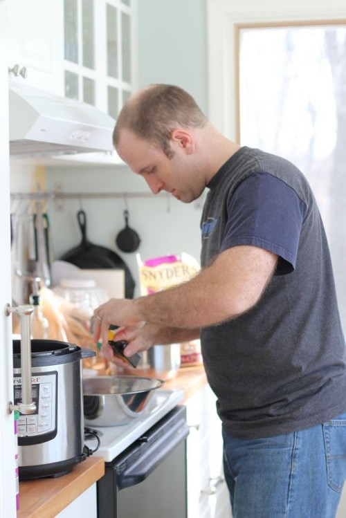 Jason cheerfully making dinner for the sick family who won't eat much of it