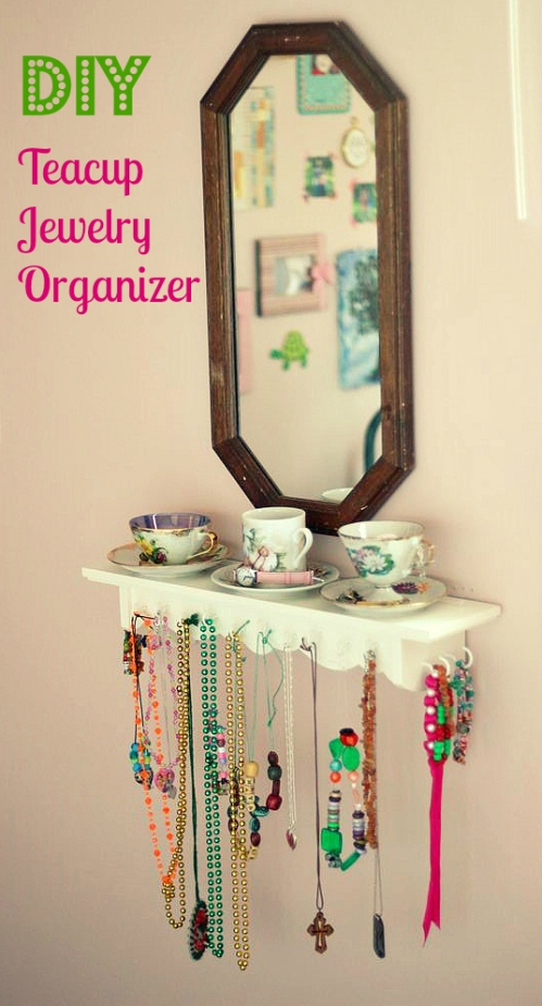 diy teacup jewelry organizer shelf and thrifted mirror